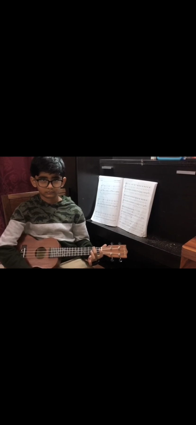 Our young student plays the Ukulele. Guitar,Piano ,Singing online classes and courses